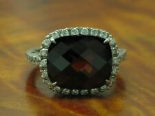 18kt 750 White Gold Ring with 0,32ct Brilliant & 15,00ct Garnet Trim/ 7,2g/ RG53