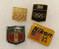 VINTAGE LOT OF 4 PINBACKS USA PENTATHLON OLYMPICS HILTON 3M NIKON LA 1984 PINS