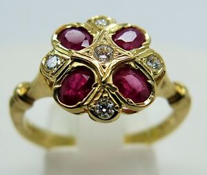 9ct yellow gold ruby and diamond ornate ring size O1/2 375