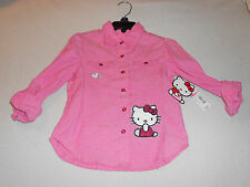 new with tags  Hello Kitty button  Pink shirt.  Girls Size 4