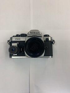 Nikon FM2 Silver And Black SLR Camera Made In Japan Body W/ Eye Magnifier.