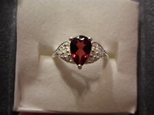 Mozambique Garnet Pear Solitaire Ring w/Simulated Diamond Accents in Sterling