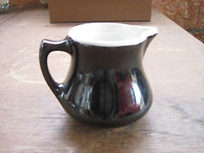 Small Black Pitcher. May hold 1/2 cup. no markings. Free Shipping