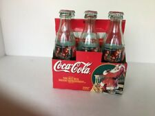 Six Pack Classic Coca-Cola Bottles/Lids VTG. Christmas 1997 Hobble Skirt Green