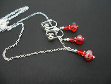 A SILVER PLATED RED CRYSTAL  NECKLACE AND  CLIP ON EARRING SET. NEW.
