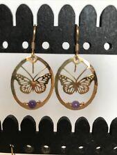 butterfly dangle earrings with purple stone