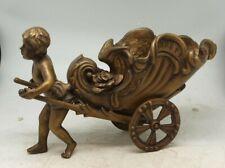 More details for bronze cherub / boy pulling wheeled cornucopia wheeled barrow - signed