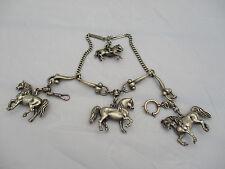 Relojes de ensueño cadenas Charivari, forma grave, tres corceles y un jinete au