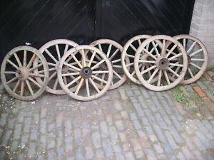 Ancient wooden cart wheels. 600mm  -  700mm diameter