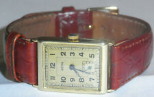 14ct BERG GOLD GENTS TANK STYLE RECTANGULAR WATCH CIRCA 1930,S FULLY WORKING