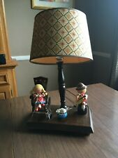 Vintage children's lamp with moving parts and music box