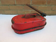 vintage old rusty red spare fuel petrol can & filler nozzle.