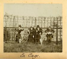 France, Groupe d'amis derrière un grillage, ca.1895, vintage citrate print