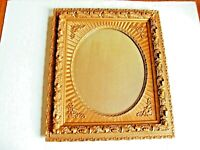 ANTIQUE ORNATE DETAILED OVAL MIRROR IN RECTANGULAR GOLD GILDED FRAME. C1900
