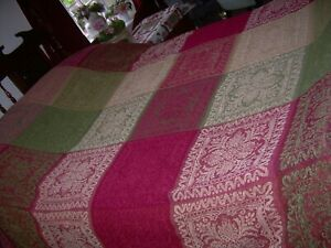 Large ethnic throw, greens, reds, beige, tassled ends. For bed or sofa.V. good.