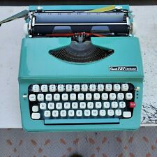 turquoise little portable vintage typewriter Grants 737 Deluxe