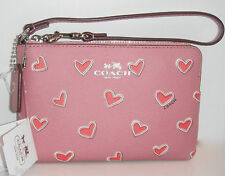COACH HEART PRINT COATED WRISTLET CORNER ZIP ROSE PINK RED VALENTINE F65571