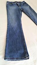 Carhartt bootcut blue jeans.