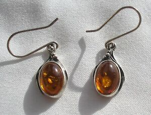 Lovely dangly Sterling Silver earrings set with Cognac Amber - pierced