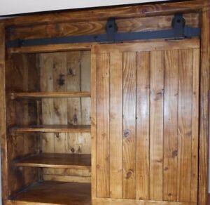 A handmade display cabinet with barn sliding door rail