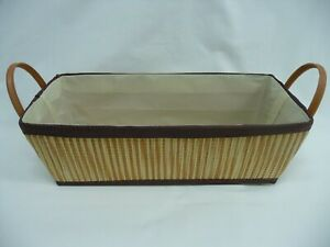 "Oblong Straw Basket With 2 Vinyl Handles Measures 16"" x 7.5"" x 5.5"" Deep"