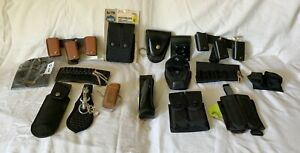 Lot of 16 GUN Magazine Pouches and other belt Accessories