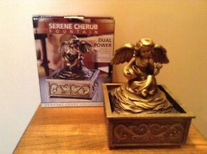 Serene Cherub Newport Castle Collection Table Fountain For Home Or Patio
