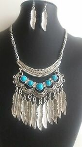 LADIES NECKLACE AND EARRING SET AZTEC DESIGN. NEW BAGGED