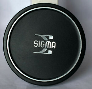 Sigma metal push on front cap to fit lenses with 62mm thread.