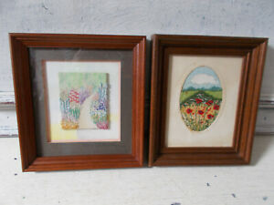 Two vintage embroidered pictures floral scenes in wooden frames