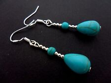 A PAIR OF TURQUOISE TEARDROP EARRINGS WITH 925 SOLID SILVER HOOKS. NEW..