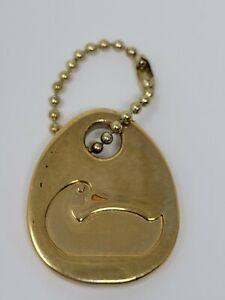 Vintage Dooney & Bourke Brass Medallion Hang Tag
