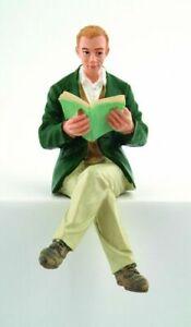 Poly resin Dolls house figure. Man sat Reading DP204
