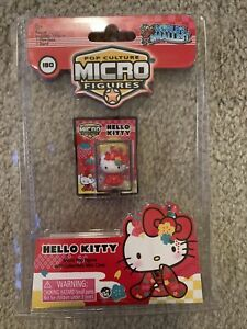 WORLDS SMALLEST HELLO KITTY 60th ANNIVERSARY JAPANESE MICRO ACTION FIGURE IN HND
