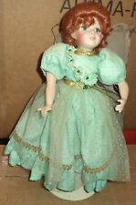 Fairy porcelain head, arms, and legs cloth body wearing green dress