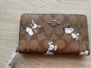 Coach X Peanuts Medium Id Zip Wallet In Signature Canvas With Snoopy Print