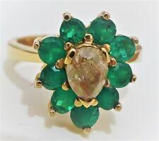 Anillo de oro 18 cts macizo con diamante marrón y esmeraldas, todo natural