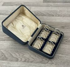 A Boxed Set Of Four George V Solid Silver Toast Racks