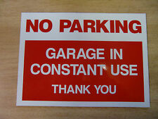 """NO PARKING - GARAGE IN CONSTANT USE""  rigid plastic warning sign (11in x 8in)"