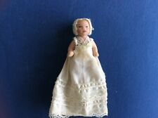Porcelain Jointed Victorian Baby in Christening Gown and bonnet Dolls House