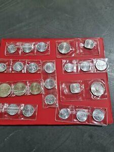 Lotto di 24 monete estere in fior di conio con scritta  cronaca numismatica