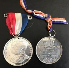 George V- 2 x 1935 Silver Jubilee commemorative medallions with ribbons