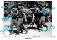 OLD 6 x 4 PHOTO AUSTRALIAN SOLDIERS CARRYING WOUNDED TARAKAN Is BORNEO c1945