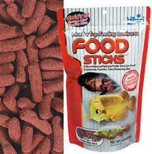 HIKARI TROPICAL CARNIVORE STICKS 2 OZ AROWANA GAR FOOD. TO THE USA