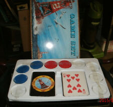 Vintage games in a lighthouse picture tincontainer from Topper Usa listed games