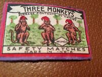 old match box top - three monkeys .made in india