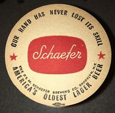 VINTAGE SCHAEFER BEER COASTER Our Hand Has Never Lost It's Skill Brooklyn, Ny