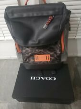 Coach mens  Ranger leather backpack with matching orange Coach leather shoes.
