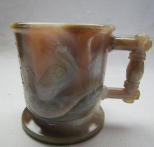 BOYD ART GLASS CHILD`S STORK AND PEACOCK CUP MUG.(BROWN AND GRAY SLAG) 1ST FIVE