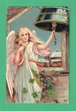 1909 EAS CHRISTMAS/NEW YEAR GEL POSTCARD ANGEL BELL SHAMROCKS MONEY VILLAGE SNOW